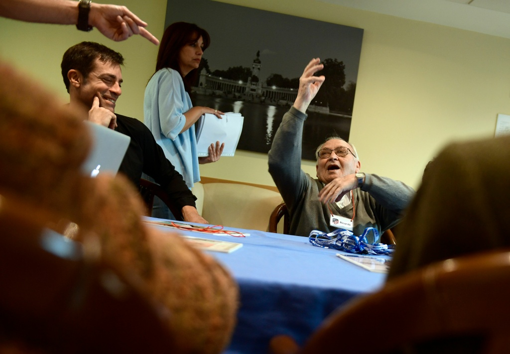 A patient affected by Alzheimer's disease gestures as he attends a special therapeutic session in Madrid, Spain on November 28, 2017.