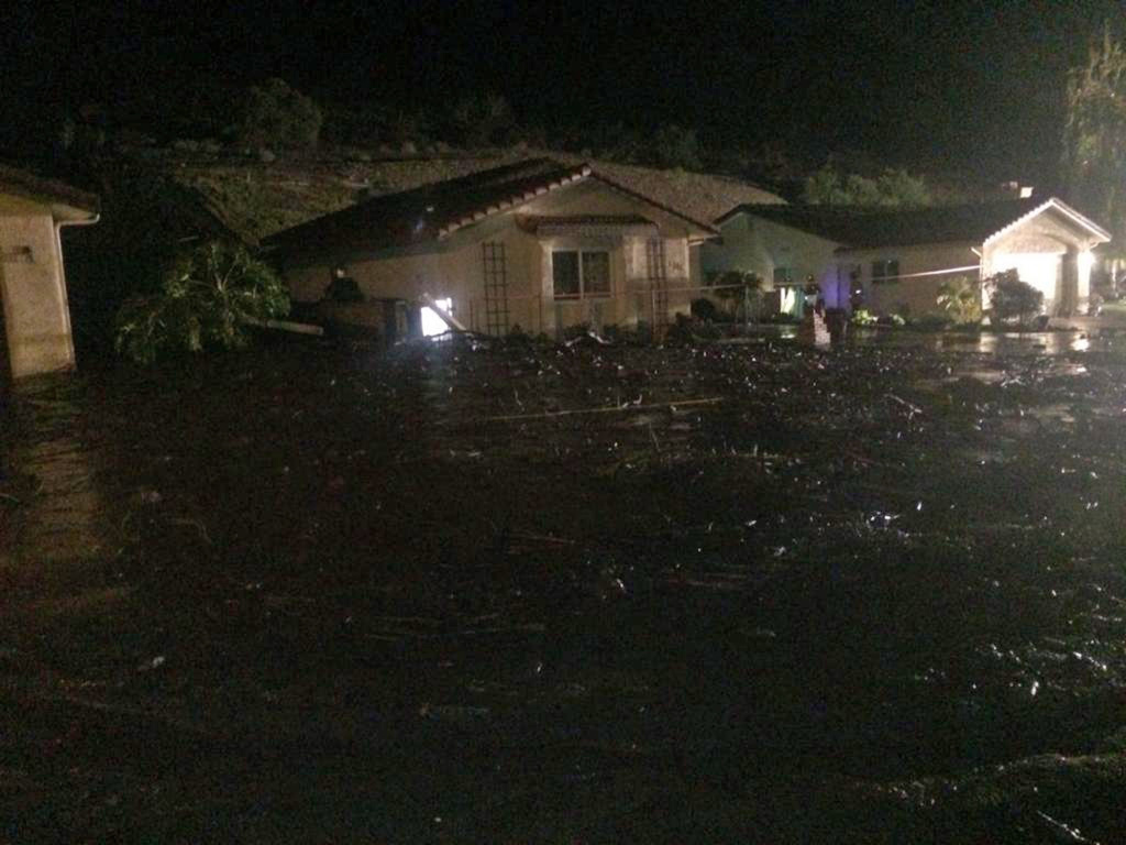 This image provided by the Ventura County Fire Department shows a home on San Como Lane in Camarillo Calif., inundated by mud and debris from a hillside early Saturday Nov. 1, 2014. Fire Capt. Mike Lindbery of the Ventura County Fire Department says residents from about 11 homes were evacuated early Saturday in the neighborhood of Camarillo.