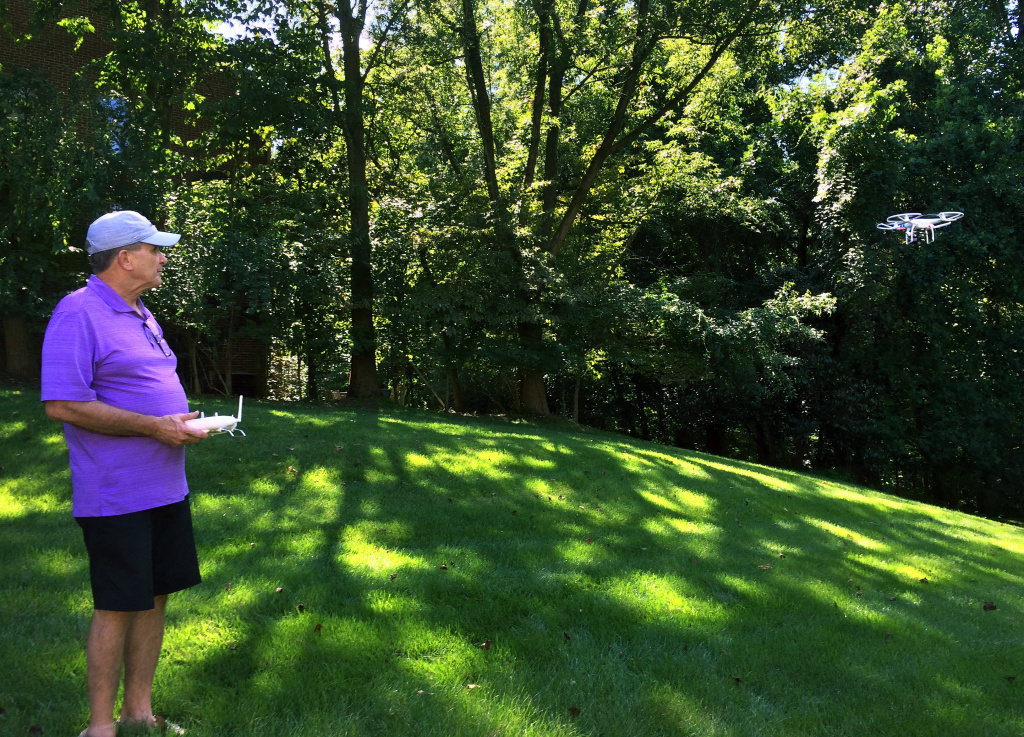 Tom Gorner, founder of Skyscape Services, flies his drone in the backyard of his Virginia home. His company uses the drone to photograph real estate for prospective buyers.
