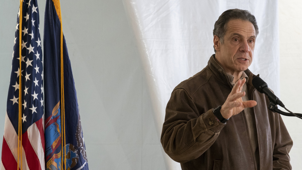 New York Gov. Andrew Cuomo speaks to reporters during a news conference at a COVID-19 pop-up vaccination site in Brooklyn on Jan. 23. Cuomo has defended the state's reporting of nursing home deaths.