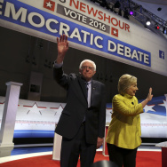 US Democratic presidential candidates Hillary Clinton and Bernie Sanders wave after the PBS NewsHour Presidential Primary Debate in Milwaukee, Wisconsin on February 11, 2016.