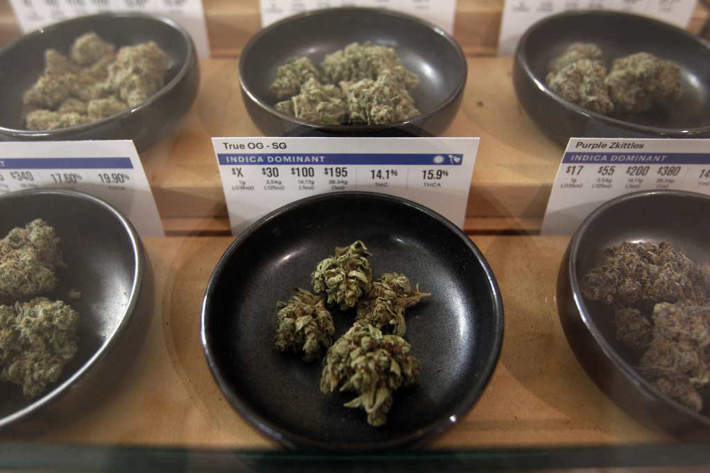 Different types of marijuana sit on display at Harborside marijuana dispensary, Monday, Jan. 1, 2018, in Oakland, Calif.