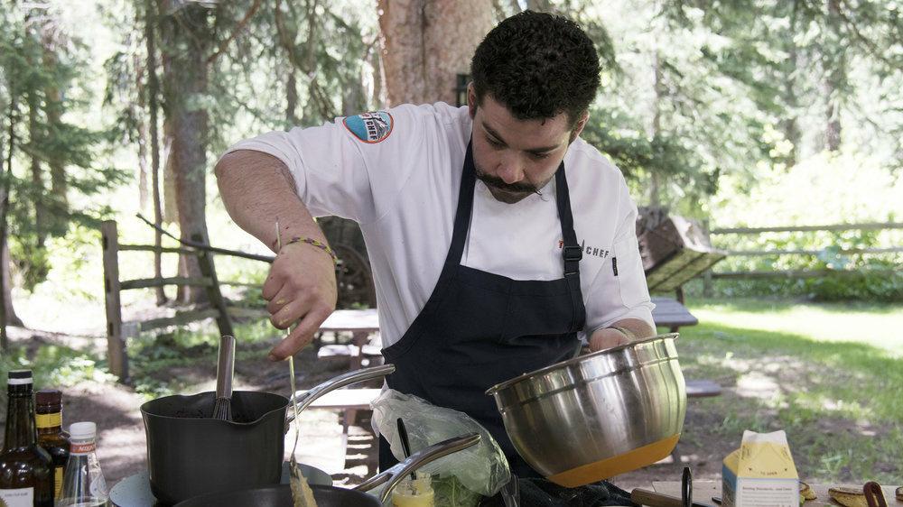 <em>Top Chef</em> contestant Joe Sasto cooks a meal in Aspen, Colo.