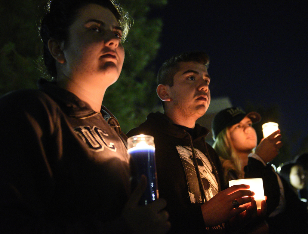 Students attend a candlelight vigil for professor William Klug at the University of California, Los Angeles, Thursday, June 2, 2016.