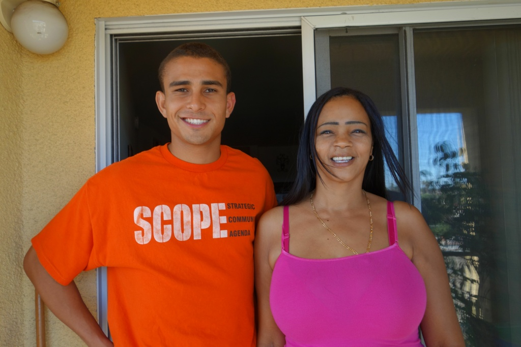 SCOPE organizer Benjamin Toney visits with South LA resident Carmen Miller about becoming more active in civic life.