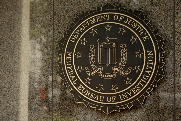 The seal of the Federal Bureau of Investigation (FBI) is seen at the J. Edgar Hoover building in Washington, D.C., U.S., on Thursday, Aug. 8, 2013. The FBI is a governmental agency as a division of the U.S. Department of Justice (DOJ) established in 1908.
