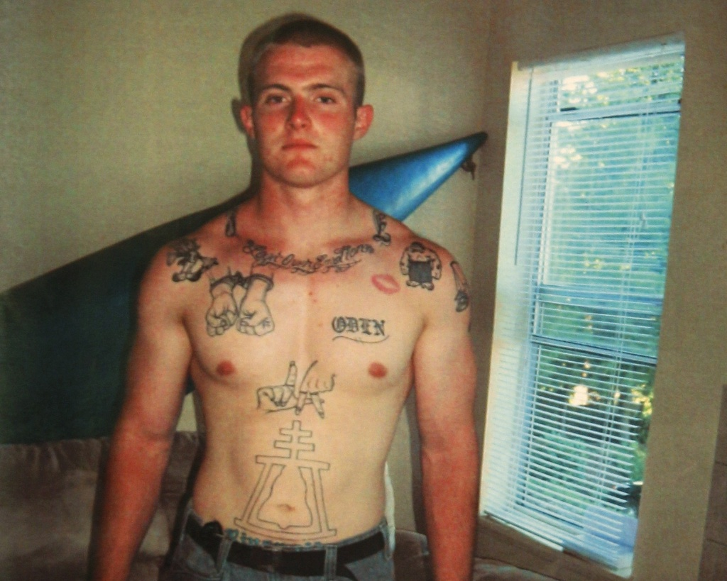 In this undated photo provided by the Pierce County Sheriff's Dept., Benjamin Colton Barnes is shown. Los Angeles and Riverside symbols can be seen tattooed to his abdomen.