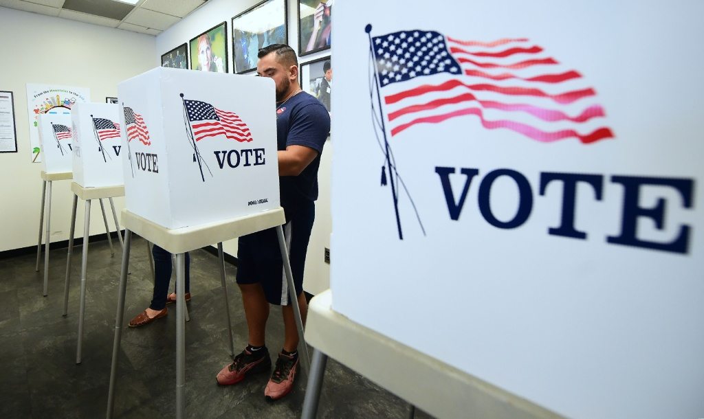 Voters cast their ballots for Early Voting at the Los Angeles County Registrar's Office in Norwalk, California on November 5, 2018.