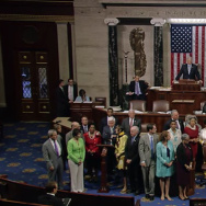 Members of the House gather as Rep. John Lewis (D-GA) delivers a speech declaring that lawmakers would conduct a sit-in until they were able to vote on gun legislation.