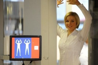 A woman is checked by a full body scanner at the airport in Hamburg, Germany.