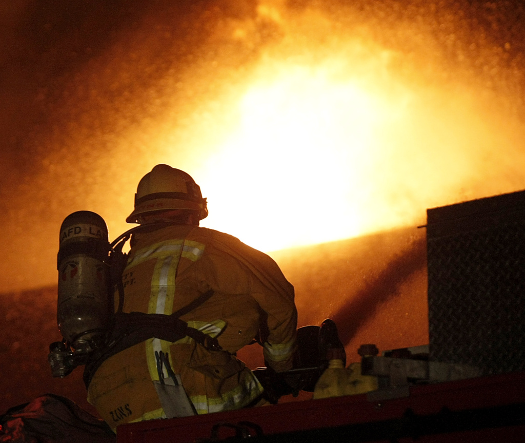 File: Firefighters with the Los Angeles City Fire Department battle a blaze in an auto body shop in the Crenshaw district of Los Angeles on Wednesday, Dec. 9, 2009.