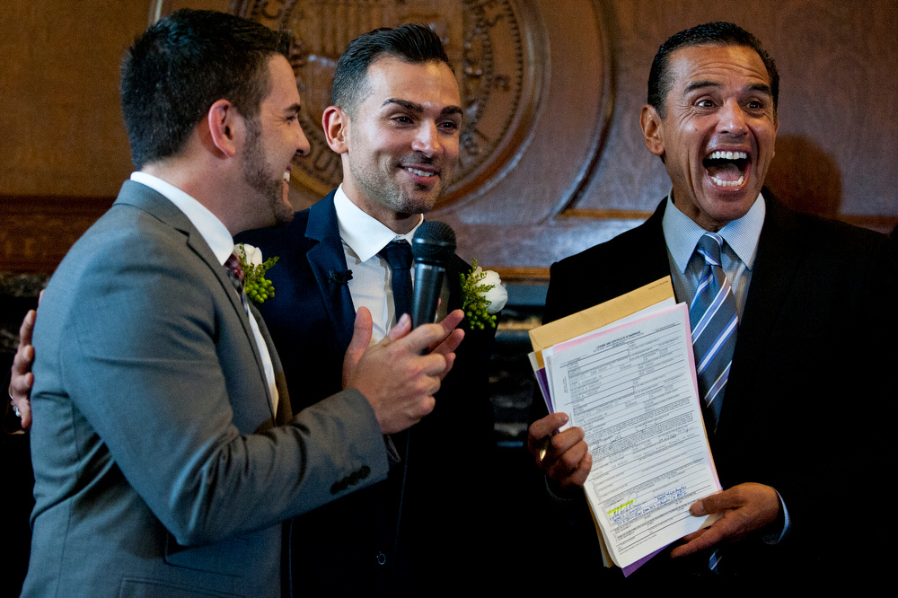 Paul Katami and Jeff Zarrillo, plaintiffs in the Supreme Court case that overturned California's same-sex marriage ban, became the first gay couple to wed in Los Angeles since 2008 on Friday at City Hall. Outgoing Mayor Antonio Villaraigosa officiated the ceremony.