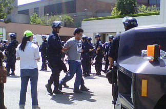 A protester is arrested at an immigration rights demonstration in downtown Los Angeles, May 6, 2010.