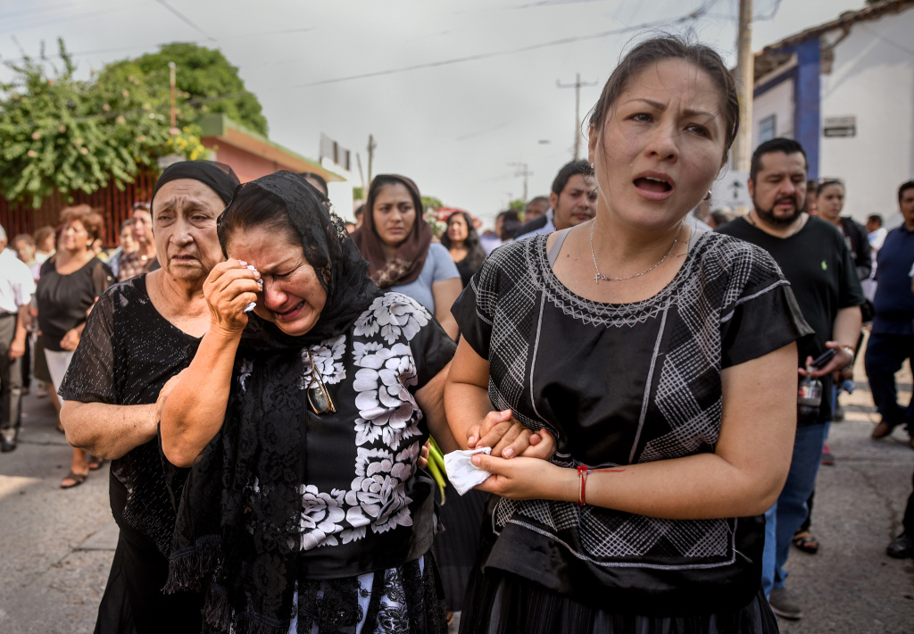 Relatives of German Torres morn at his funeral. He was killed in Juchitan de Zaragoza, state of Oaxaca, by the earthquake that hit Mexico's Pacific coast on September 9, 2017.