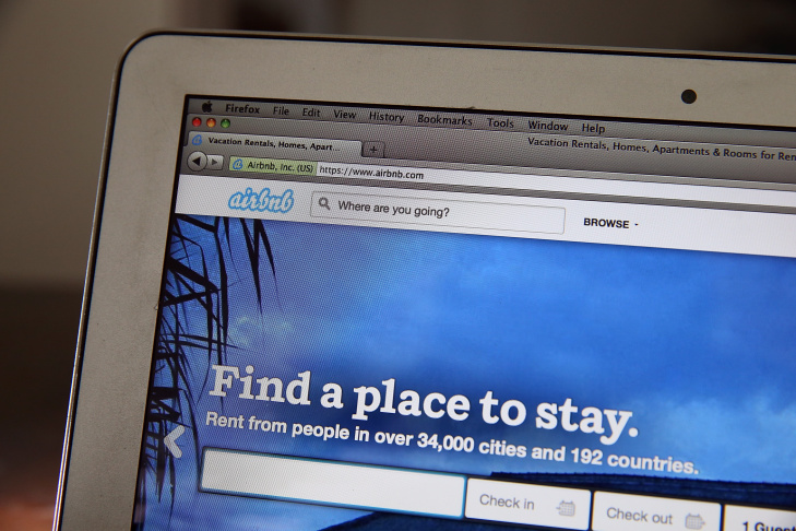 File: The Airbnb website is displayed on a laptop on April 21, 2014 in San Anselmo, California. In a forum Monday, 10 of 14 candidates vying for a Los Angeles city council seat discussed the growing use of Airbnb in their district - and many said it ought to be taxed.