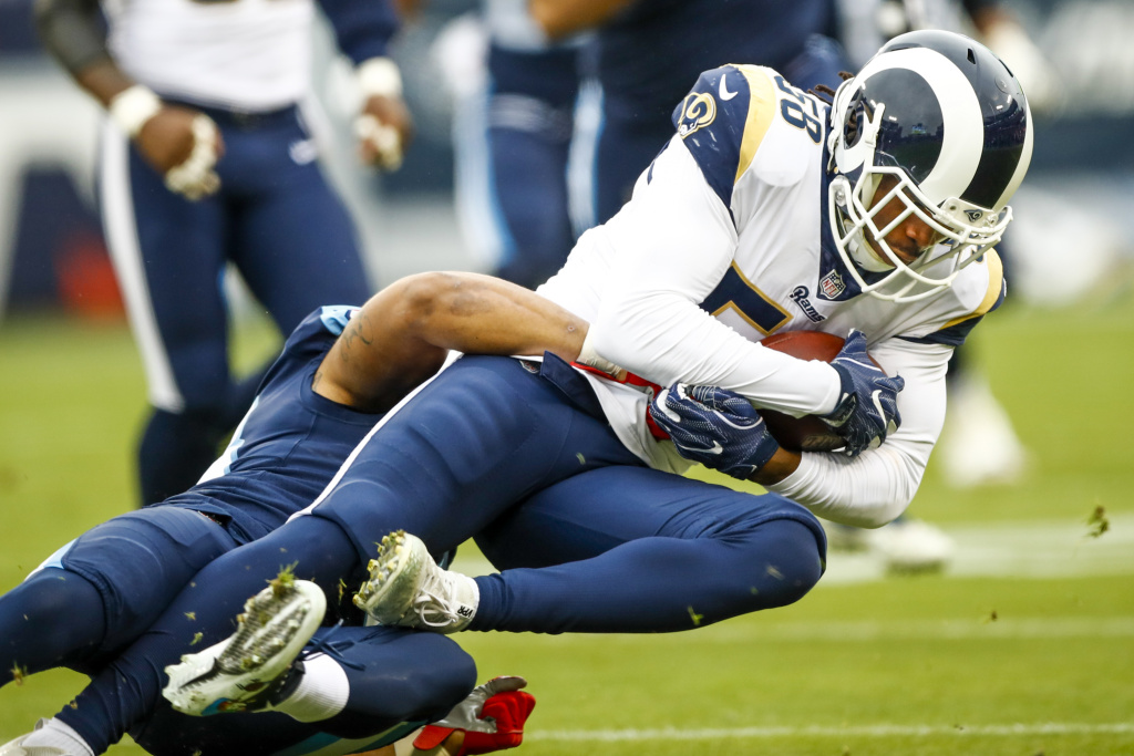 Outside Linebacker Cory Littleton #58 of the Los Angeles Rams carries the ball after an interception against the Tennessee Titians at Nissan Stadium on December 24, 2017 in Nashville, Tennessee.