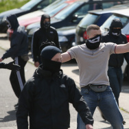 Anti-Nazi activists taunt supporters of the far-right NPD political party marching on May Day in Dierkow district on May 1, 2014 in Rostock, Germany. Left-wing protesters repeatedly blocked the route of the approximately 250 NPD supporters and at one point attacked them with rocks.