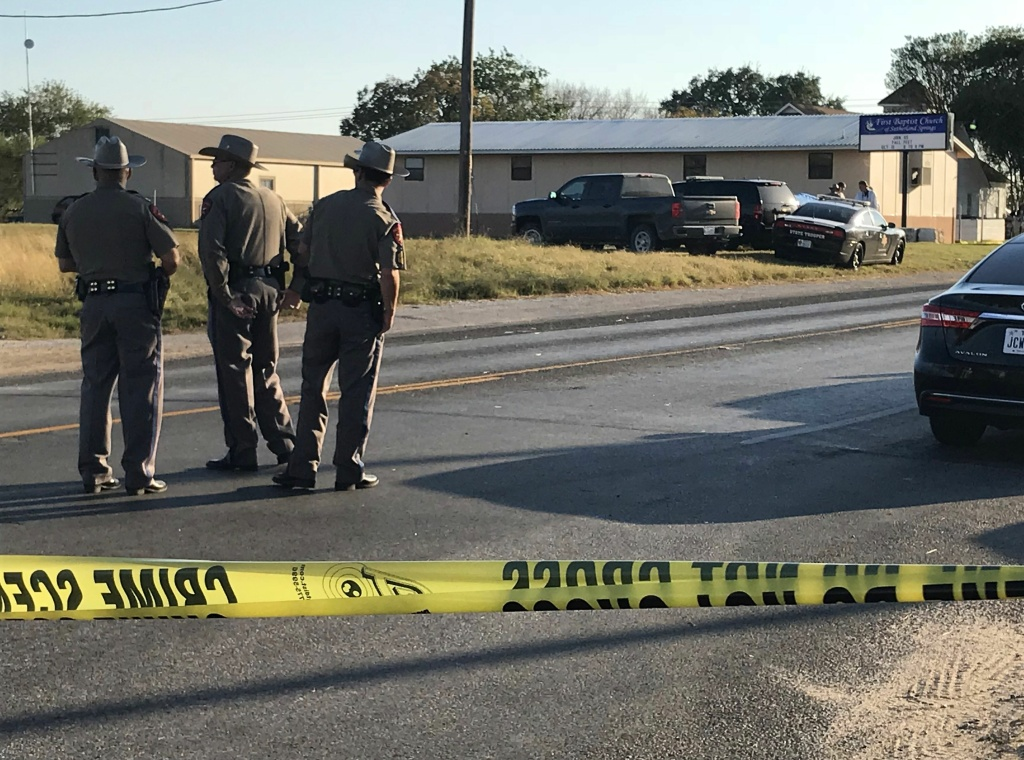 Police block a road in Sutherland Springs, Texas, on November 5, 2017, after a mass shooting at the the First Baptist Church.