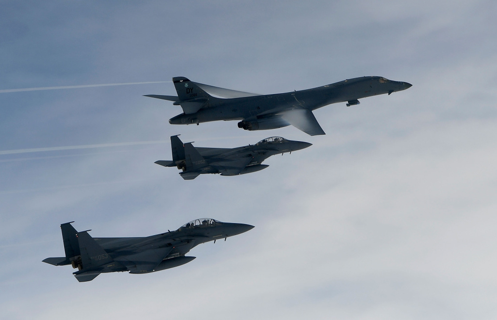 A U.S. Air Force B-1B Lancer bomber (top) fly with South Korean jets over the Korean Peninsula during a South Korea-U.S. joint live fire drill on July 8, 2017 in Korean Peninsula, South Korea.