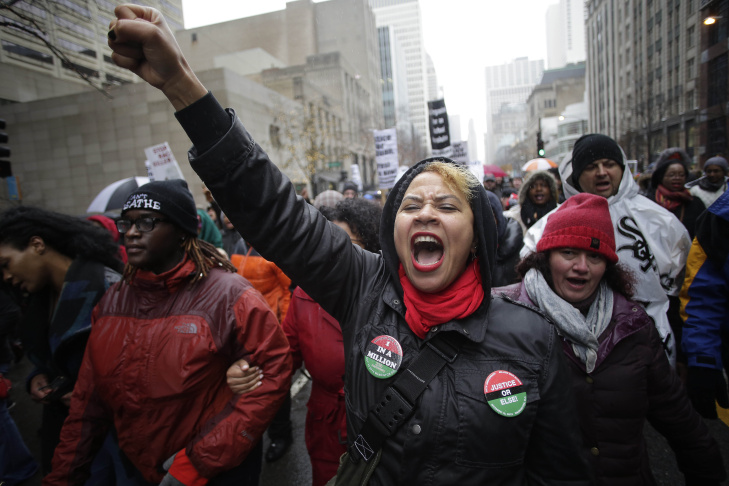 Demonstrators protest the shooting of Laquan McDonald along the Magnificent Mile November 27, 2015 in Chicago, Illinois. Chicago police officer Jason Van Dyke was charged Tuesday with first degree murder for fatally shooting 17-year-old McDonald 16 times last year on the southwest side of Chicago after Van Dyke was responding to a call of a knife wielding man. The dash-cam video of officer Van Dyke shooting McDonald was released by the Chicago Police department earlier this week after a judge denied Van Dyke bail during his bond hearing at Leighton Criminal Court.