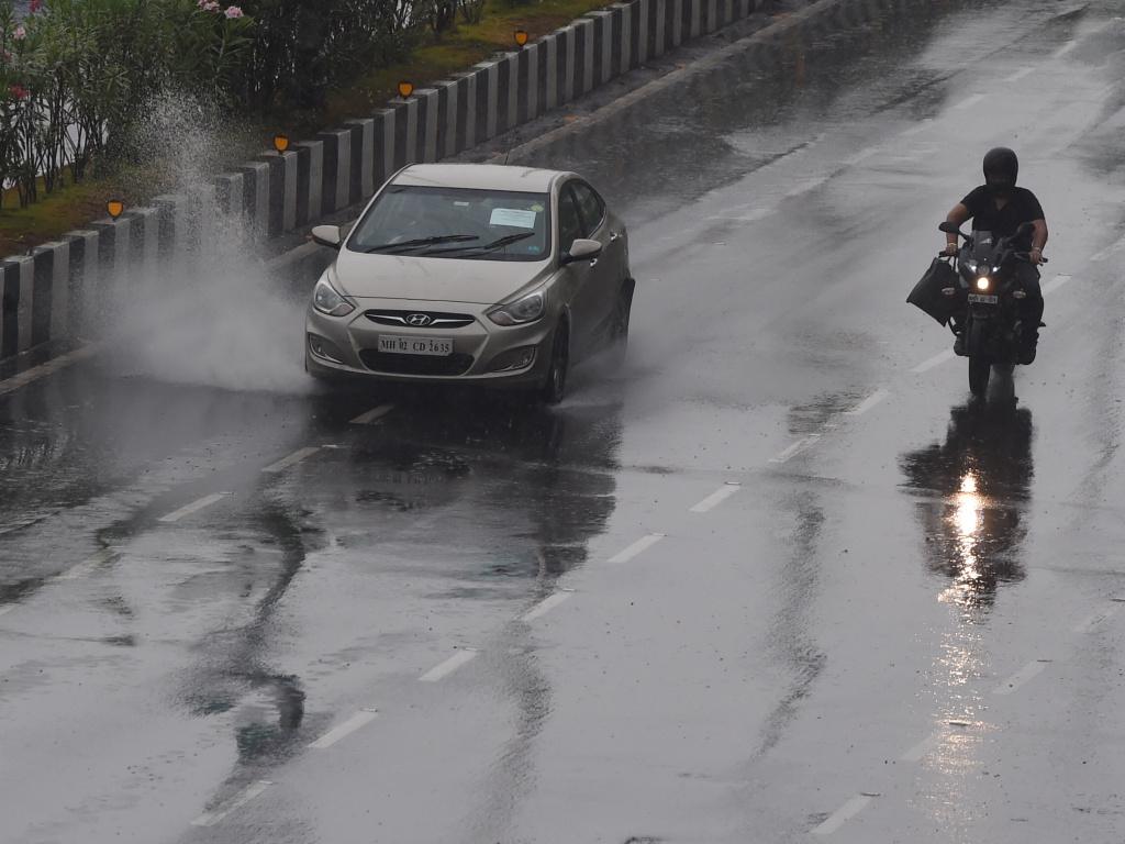 Commuters drive along Marine Drive amid heavy rainfall in Mumbai on Wednesday as cyclone Nisarga neared landfall on India's west coast.