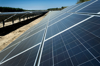 File: A 32-megawatt Long Island photovoltaic array being built in the southeast corner of the Brokhaven National Laboratory site.