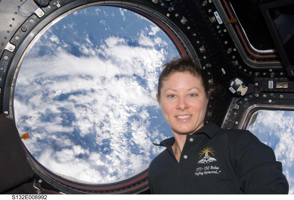 NASA astronaut Tracy Caldwell Dyson inside the International Space Station's Cupola, a seven-windowed turret-like module on the orbital outpost.