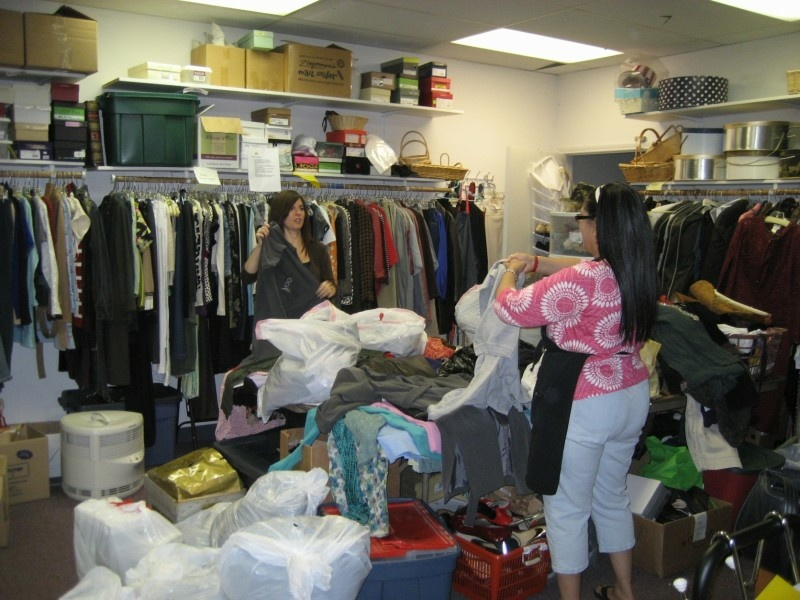 Workers sort through donated clothes on a recent slow Saturday at Classy Seconds in Costa Mesa.  The store is mostly staffed by volunteers.  It helps fund a local battered women's shelter.