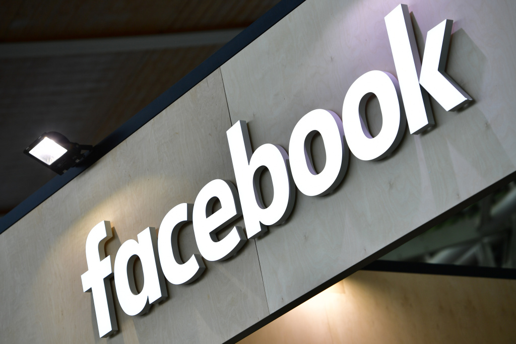 The Facebook logo is displayed at the 2018 CeBIT technology trade fair on June 12, 2018 in Hanover, Germany