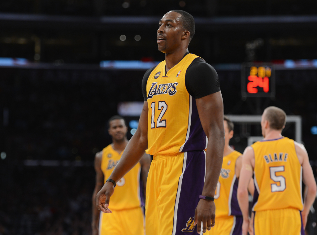 Dwight Howard #12 of the Los Angeles Lakers heads to the bench during the game against the Minnesota Timberwolves at Staples Center on February 28, 2013 in Los Angeles, California.