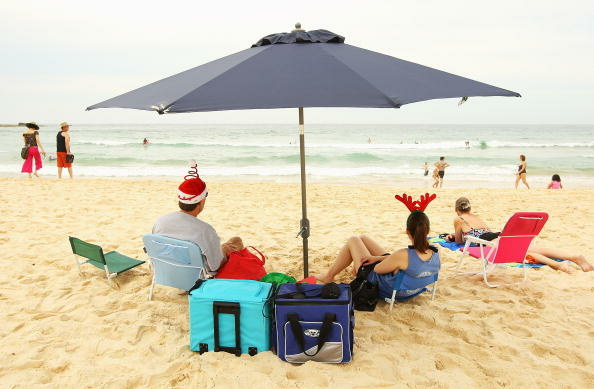 A family from the United States relax during Christmas Day at Bondi Beach on December 25, 2009 in Sydney, Australia.