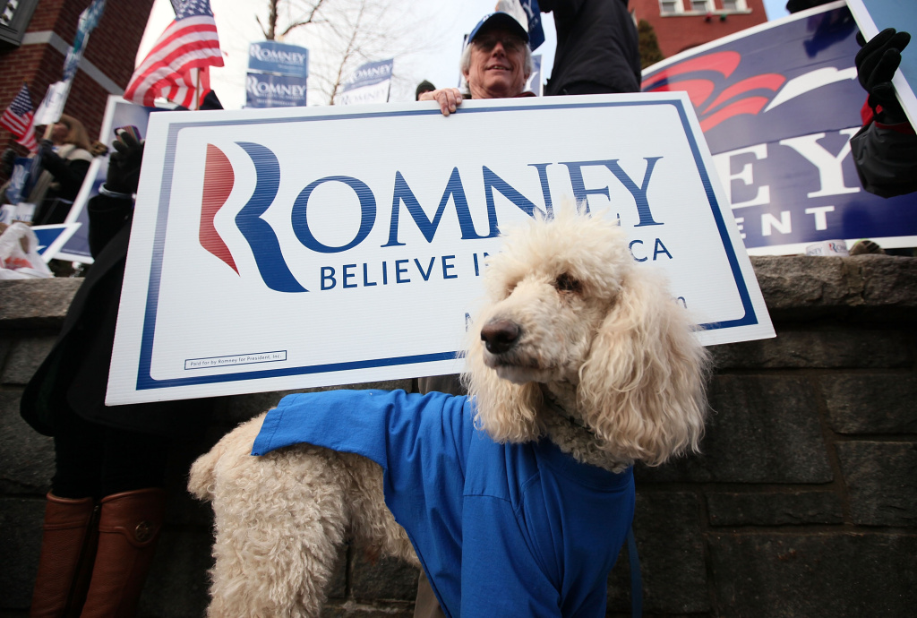 Supporter of Republican presidential candidates and former Massachusetts Gov. Mitt Romney, Bill Gordon of Loudon, New Hampshire, holds sign with his dog Miles, January 8, 2012 in Concord, New Hampshire.