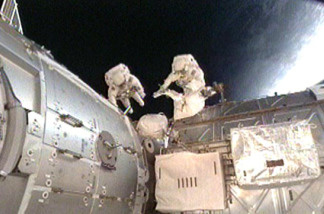 Mission Specialists Nicholas Patrick and Robert Behnken work outside the International Space Station during the second spacewalk of the STS-130 mission.