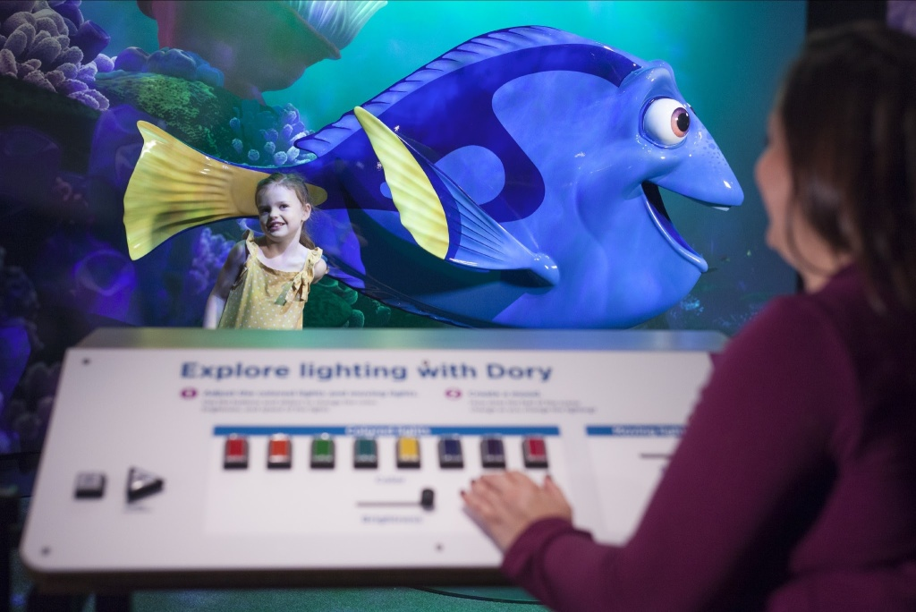Visitors adjust the lighting for their photo with Dory.