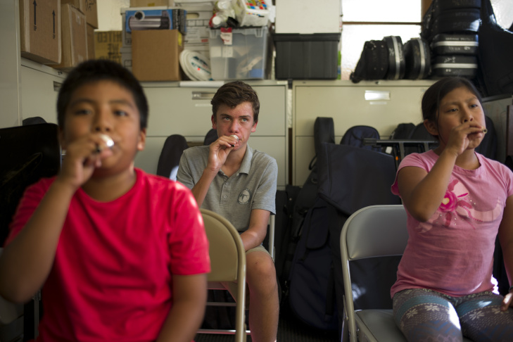 Kevin Santiago, from left, Liam Larsen, Esmeralda Martinez blow on their trombone mouthpieces during their trombone lesson offered by Harmony Project, a Los Angeles-based nonprofit that provides free music lessons to low-income students, Thursday, Aug. 28, 2014, in Los Angeles. A two-year study of dozens of schoolchildren from disadvantaged Los Angeles neighborhoods shows that music training changes the brain in ways that make it easier for youngsters to process sounds, according to results reported in Tuesday's edition of the journal Neuroscience.