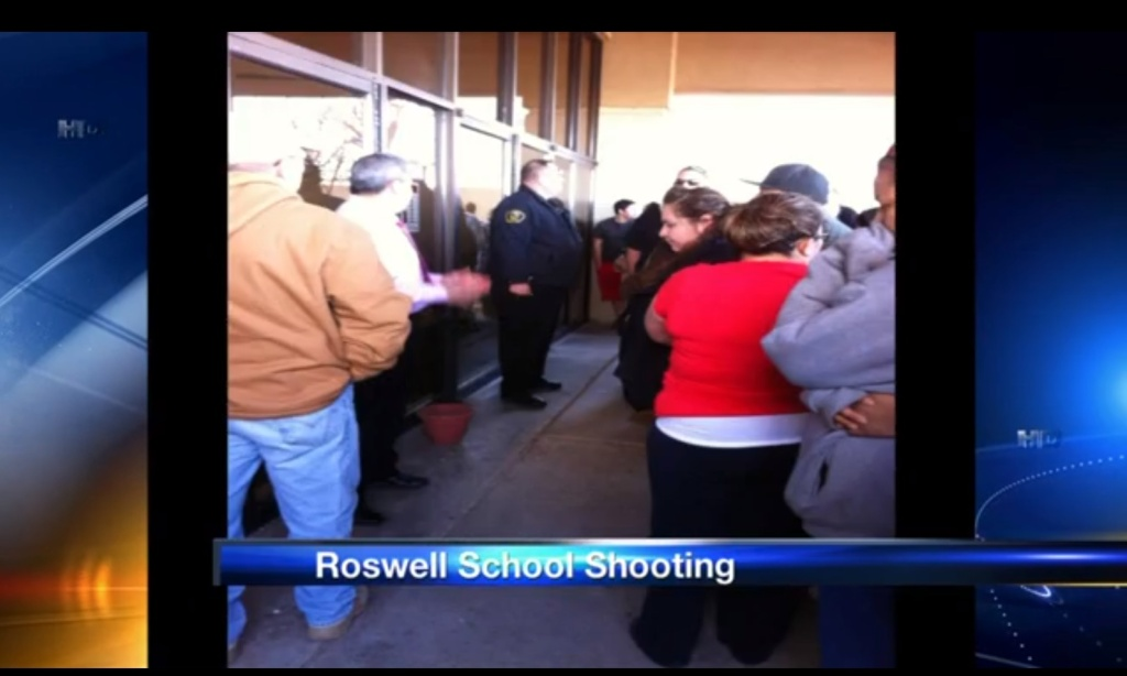 A screencap from New Mexico TV station KRQE-13 of the shooting on Tuesday, Jan. 14, 2014, at a Roswell, N.M., middle school that left two children injured and a 12-year-old boy in custody.