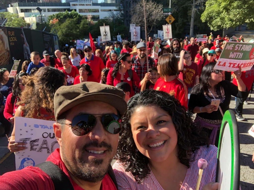 LAUSD parents Virginia Escamilla and Hugo Albuja march to support teachers leading up to their strike. Photo courtesy of Hugo Albuja.