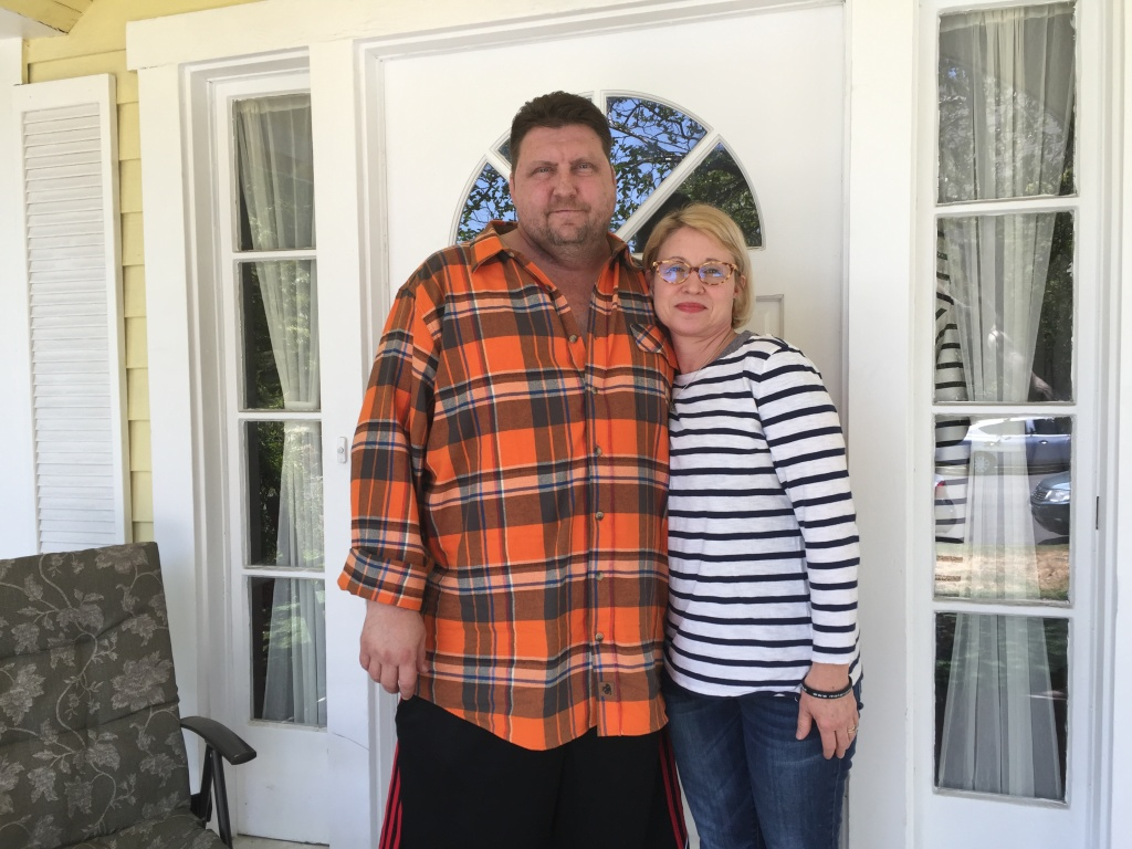Matt Fairchild and his wife, Ginger, stand in front of his Burbank home.