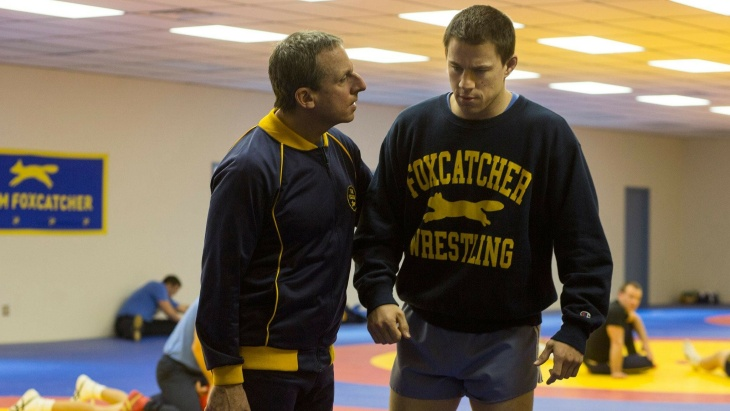 Steve Carrell (left) as John du Pont; Mark Ruffalo (with beard) as David Schultz; and Channing Tatum (without shirt) as Mark Schultz in the upcoming film
