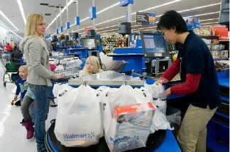 A Walmart cashier standing at her job.