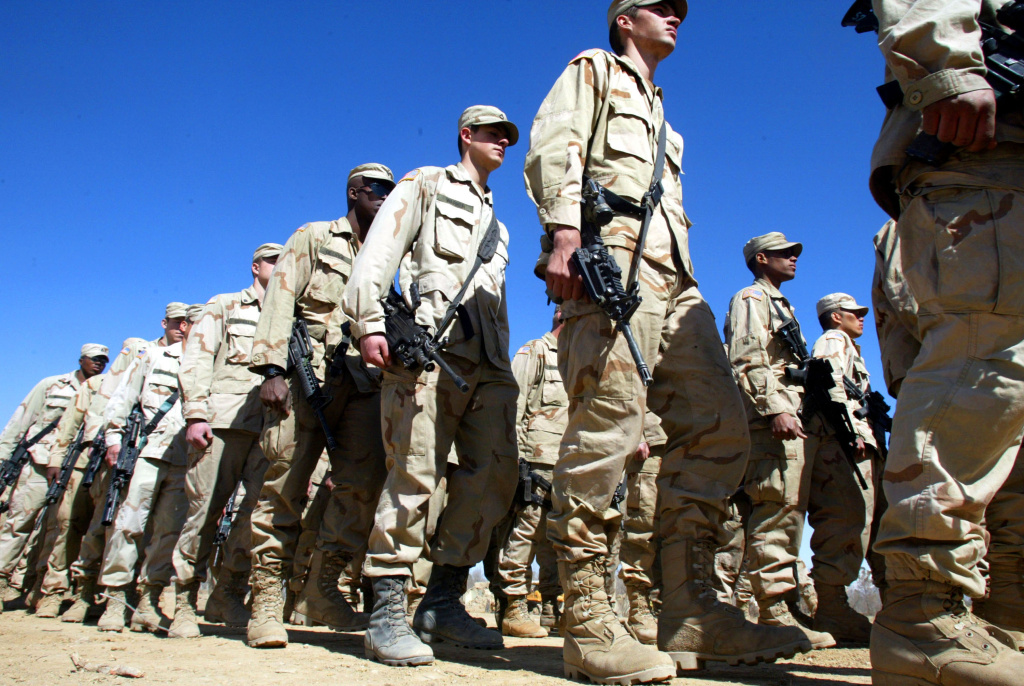 U.S. Army 10th Mountain Division soldiers march in formation March 13, 2002 after receiving a pep talk from Col. Frank Wiercinski at the Bagram Air Base near Kabul, Afghanistan.