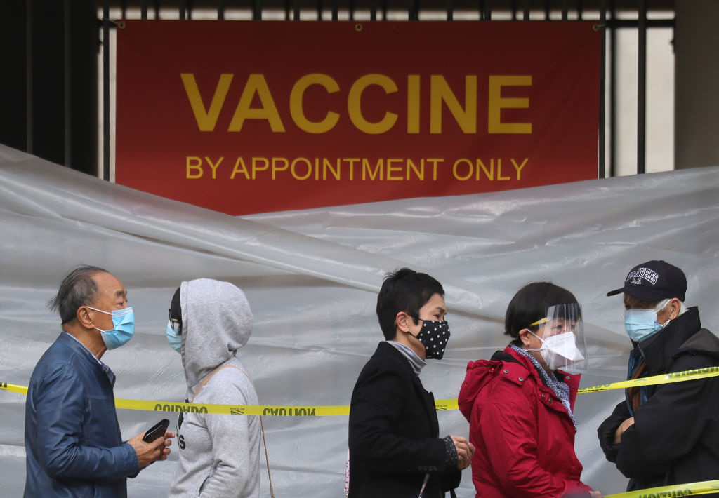 People with appointments stand in line to receive the COVID-19 vaccine at a vaccination site at Lincoln Park in East Los Angeles amid eased lockdown restrictions on January 28, 2021 in Los Angeles, California.