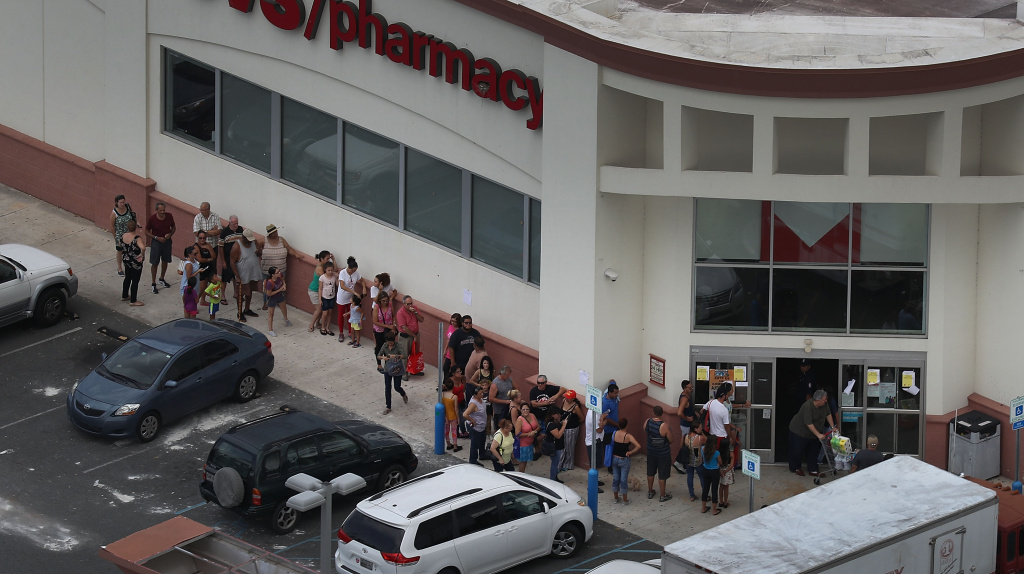 People line up at a CVS store as they deal with the aftermath of Hurricane Maria on September 25, 2017 in Levittown, Puerto Rico.