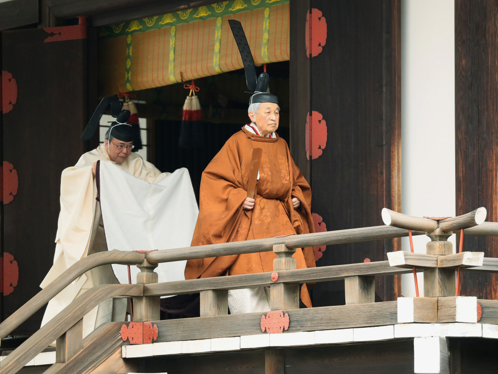 Japan's Emperor Akihito (right) leaves after a ritual to report his abdication to the throne at the Imperial Palace in Tokyo on Tuesday.