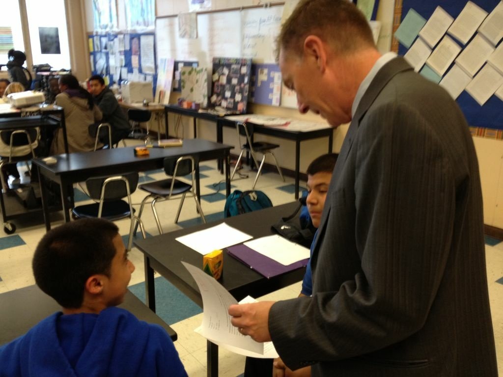 Superintendent John Deasy talks with two students in an honors English class about Toni Morrison's