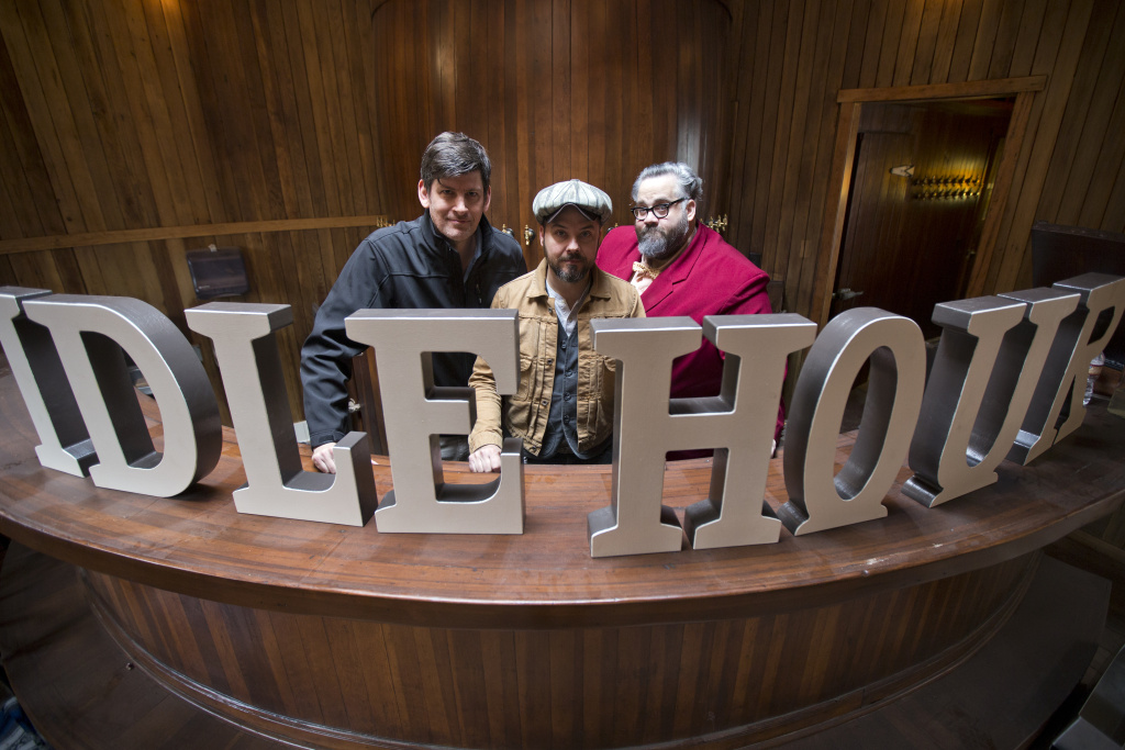 Off-Ramp host John Rabe, left, Bobby Green of 1933 Group and writer Chris Nichols stand with the new lettering for Green's Idle Hour Cafe in North Hollywood on Tuesday, Jan. 20.