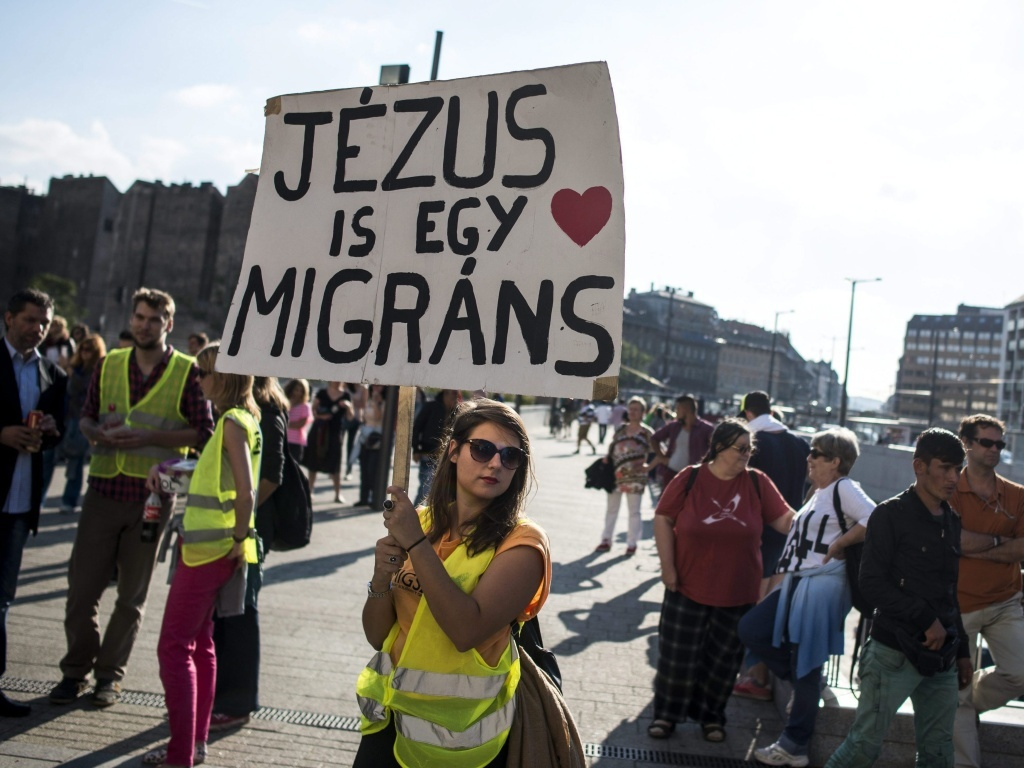 People taking part in a demonstration in support of migrants called the 'Solidarity Day' gather at the Keleti railway station in Budapest, Hungary, on Saturday.