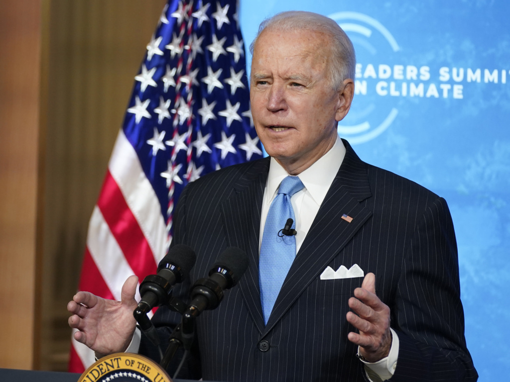 President Biden speaks to world leaders during a virtual climate summit on Friday from the East Room of the White House. The event was part of an effort to restore U.S. leadership on environmental issues after the Trump administration pulled back.
