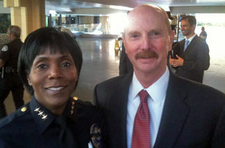 Ethel McGuire, assistant police chief for Los Angeles World Airports, and Randy Parsons, Los Angeles director of the Transportation Security Administration (TSA).