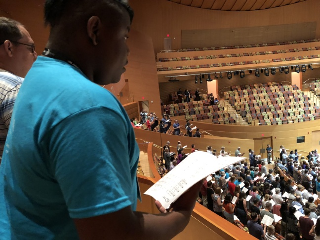 The rehearsal gave singers a chance to meet each other, and to be conducted by composer Eric Whitacre.